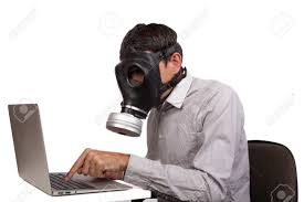 Man With Gas Mask Working With Silver Laptop Isolated On White.. Stock  Photo, Picture And Royalty Free Image. Image 28112552.
